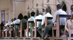 People in a Sri Lankan church wait for mass to begin Stock Footage
