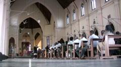 People entering a Sri Lankan church Stock Footage