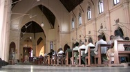 Waiting for mass to begin in a Sri Lankan church Stock Footage