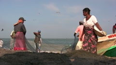 Fishing in Sri Lanka, women sorting out nets at the beach Stock Footage
