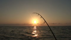 Sunset Fishing Pole Fish On Stock Footage