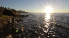San Diego Sunset, Pacific ocean waters against large rocks at the coastline Stock Footage