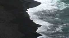 El golfo waves on black lava beach background Stock Footage