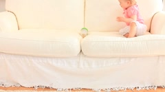Cute baby on a sofa Stock Footage