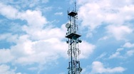Stock Video Footage of Telecommunication Tower Among The Clouds
