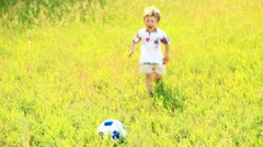 Little football player scores a goal - stock footage