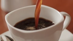 Sequence of fresh coffee pouring Stock Footage