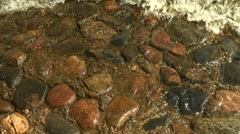 Red granite under water Stock Footage