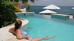 Lounging in the pool at Cap Maison, St. Lucia - stock footage