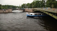 Fontanka and Moyka rivers crossing with touristic boat skyline pan Stock Footage