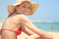 Portrait of beautiful woman in summer hat sunbathing NTSC Stock Footage