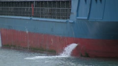 Water pumped out of Cargo ship - stock footage