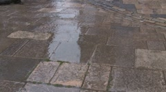Flag stones rain hitting large paving stone Stock Footage