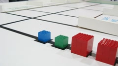 Robot is sorting bricks by color and shape - stock footage