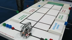Robot is sort bricks by color and shape at ROBOFEST-2011 Stock Footage