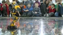 Children watch at robot dancing during ROBOFEST-2011 Stock Footage