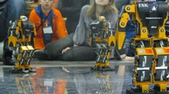 Children watch at humanoid robots dancing during ROBOFEST-2011 Stock Footage