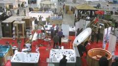 People walk in jacuzzi area at exhibition AQUA-SALON Stock Footage