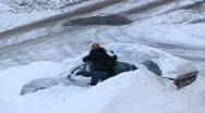 Stock Video Footage of Woman try to dig out her car after snow storm