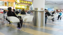 People dine in Auchan hypermarket Stock Footage