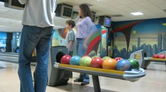 Family play bowling in PLANET club Stock Footage