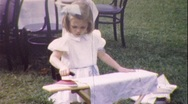 Stock Video Footage of LITTLE GIRL IRONING Playing House 1940s (Vintage Film 8mm Retro Home Movie) 211