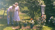 HOME Rose GARDENING Bushes Gardeners Couple 1950s Vintage Home Film Movie 205 Stock Footage