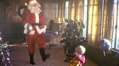 DANCING SANTA and Little Boy Circa 1975 (Vintage Film 8mm Home Movie) 223 - stock footage