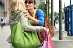 Two female friends meeting after shopping in the city NTSC Stock Footage