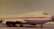 Stock Video Footage of Boeing 747 Moving on Runway Circa 1975 (Vintage Film 8mm Home Movie) 246