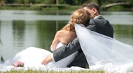 Stock Video Footage of newlyweds embracing on  shore of Lake