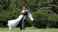 Stock Video Footage of bride spinning groom  in the park