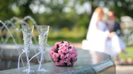 Bridal bouquet and two glasses of champagne Stock Footage