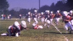 Stock Video Footage of Jr. High School Football Players on Field Run 1960s Vintage Film Home Movie 242