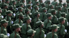 Cuban soldiers with guns march in formation Stock Footage