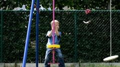 Little boy on swing - stock footage