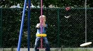 Little boy on swing Stock Footage