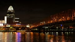 Cincinnati riverfront skyline and Roebling Bridge at night. Stock Footage