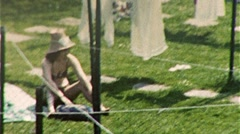 Sunbathing Woman in Backyard Circa 1957 (Vintage 8mm Home Movie Footage) 258 - stock footage
