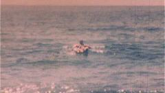 Woman Floating At the Beach Ocean in Water 1950s Vintage Film Home Movie 254 Stock Footage