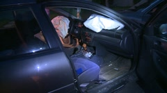 Auto accident, deployed airbags and booze bottles, stolen car Stock Footage