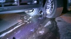 Auto accident, wheels bent, debris on road Stock Footage