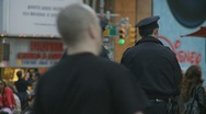 Crowds pass NYC Cops Stock Footage