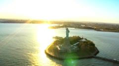 Aerial view of the Statue of Liberty, at Sunset New York Harbor, NY, USA Stock Footage