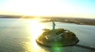 Stock Video Footage of Aerial view of the Statue of Liberty, at Sunset New York Harbor, NY, USA