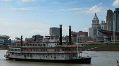 Riverboat passing Cincinnati skyline on Ohio river Stock Footage