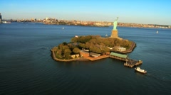 Stock Video Footage of Aerial view of the Statue of Liberty, and Downtown Manhattan, NY, USA