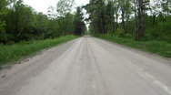 Unpaved road in forest Stock Footage