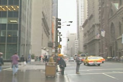 Two women with shopping bags hail a cab in New York - stock footage