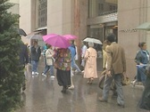 Stock Video Footage of People outside Tiffany & Co, 5th Ave on a rainy Manhattan day